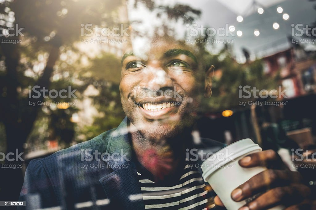 Portrait of a man on the window of a cafe stock photo