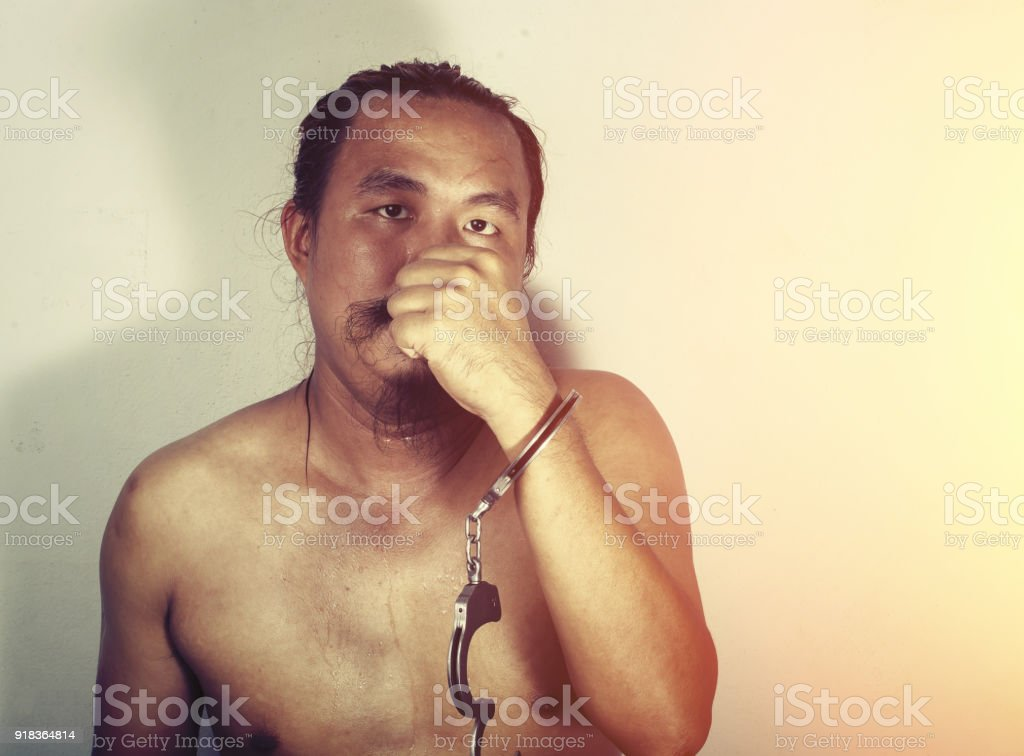 portrait of a man prisoner with handcuff stock photo