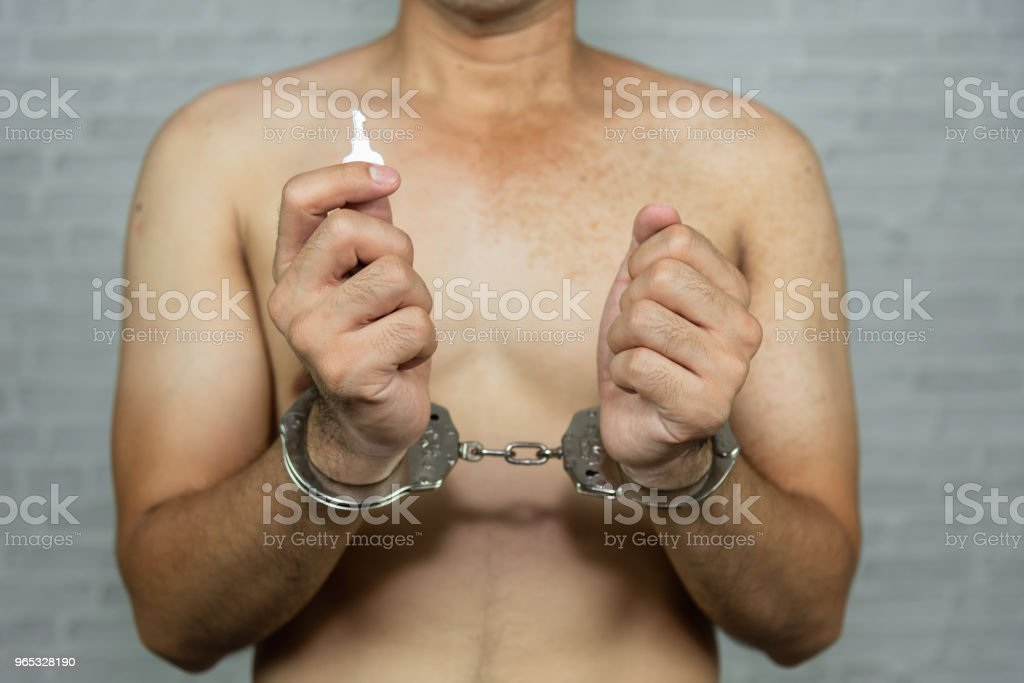 portrait of a man prisoner with handcuff royalty-free stock photo