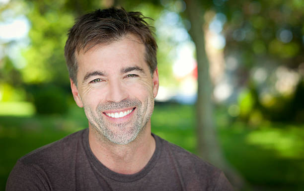 Portrait Of A Man Smiling At The Camera stock photo