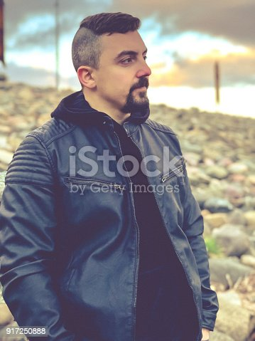istock Portrait of a man standing outdoors and contemplating 917250888