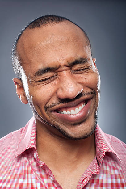 Portrait of a man suffering pain http://www.vela-photo.com/istock/studioportrait.jpg cheesy grin stock pictures, royalty-free photos & images