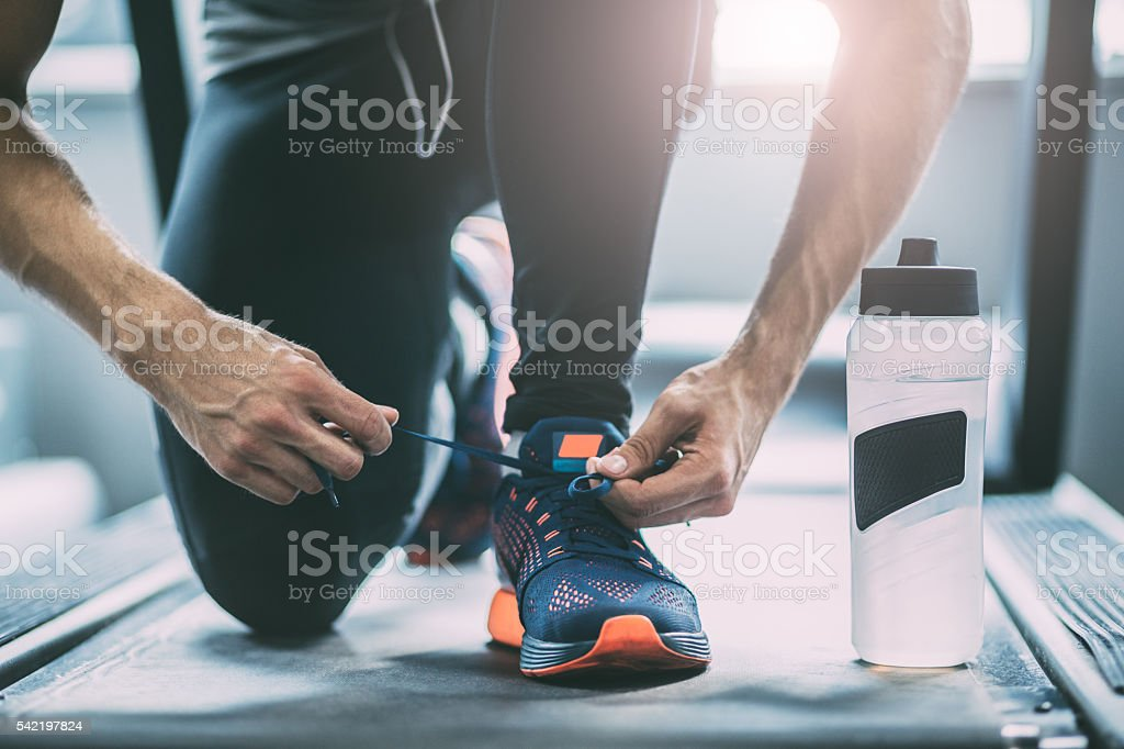 Portrait of a man tying shoelaces stock photo
