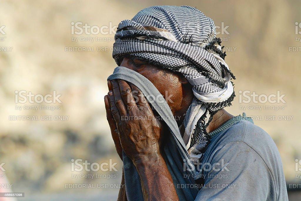 Portrait of a man wearing head scarf in Aden, Yemen. stock photo