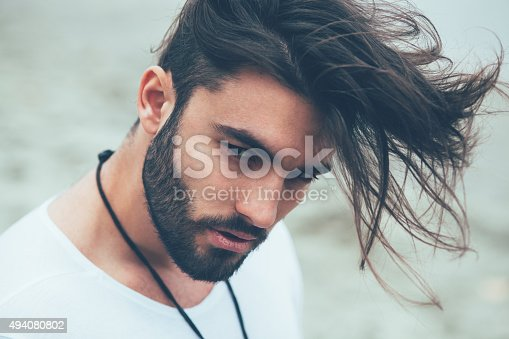 istock Portrait of a man with beard and modern hairstyle 494080802