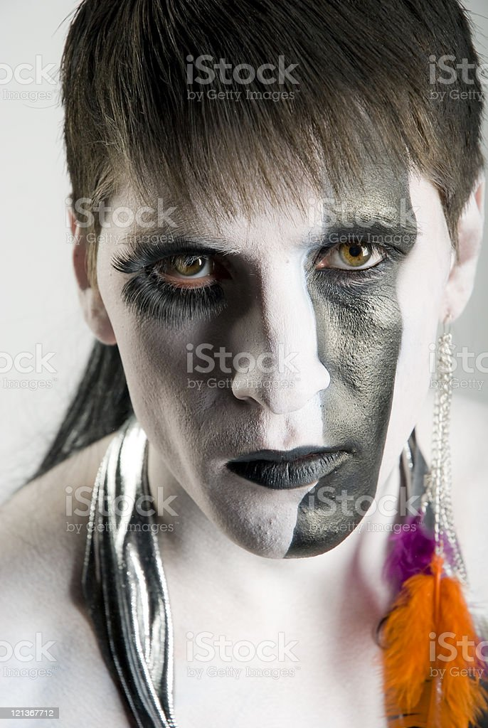 Portrait of a man with face paint stock photo