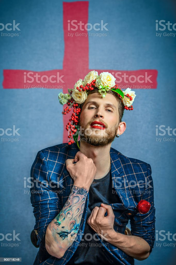 portrait of a man with flowers stock photo