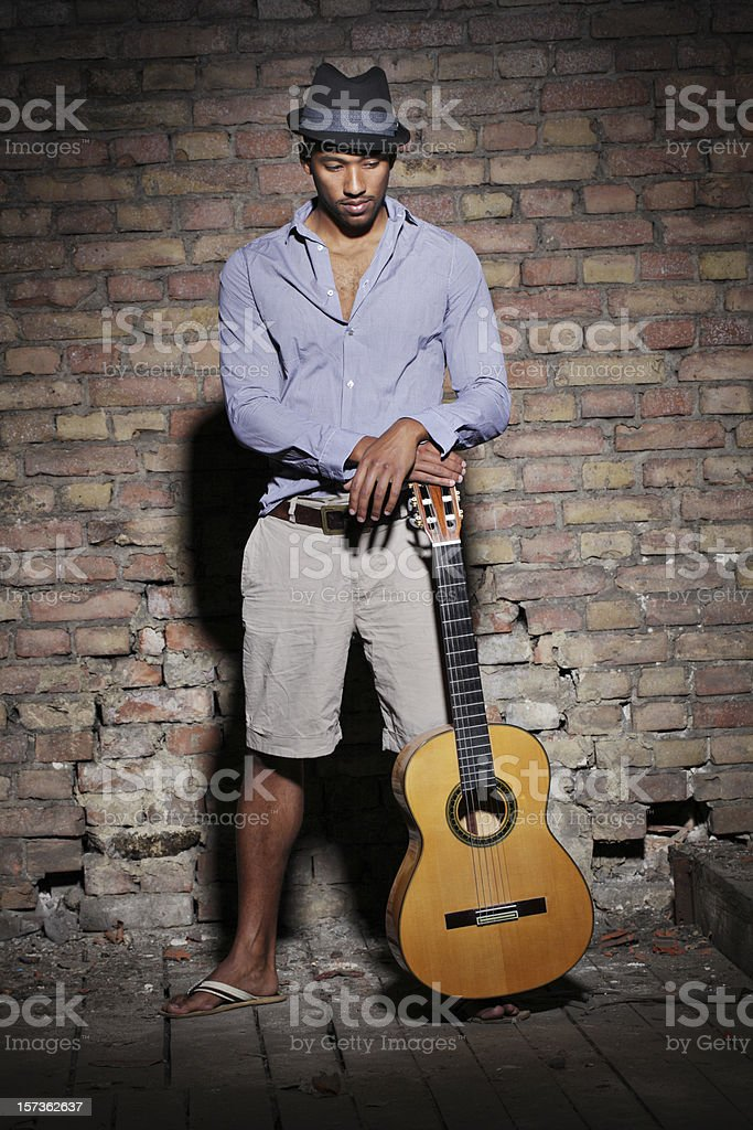 Portrait of a Man with Hat and guitar stock photo