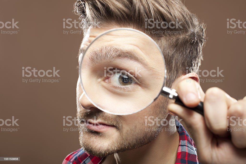 Portrait of a man with magnifying glass stock photo