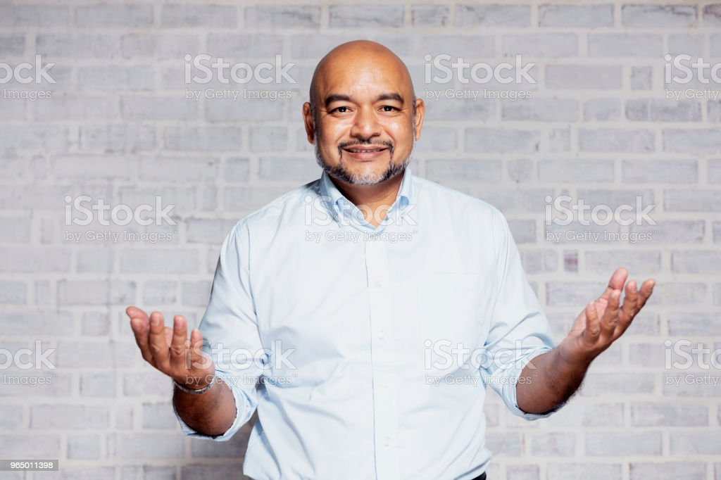 Portrait of a man with open arms gesturing welcome stock photo