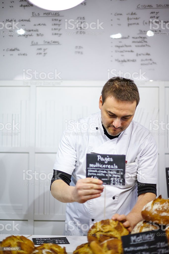 Portrait of a man working on a bakery stock photo