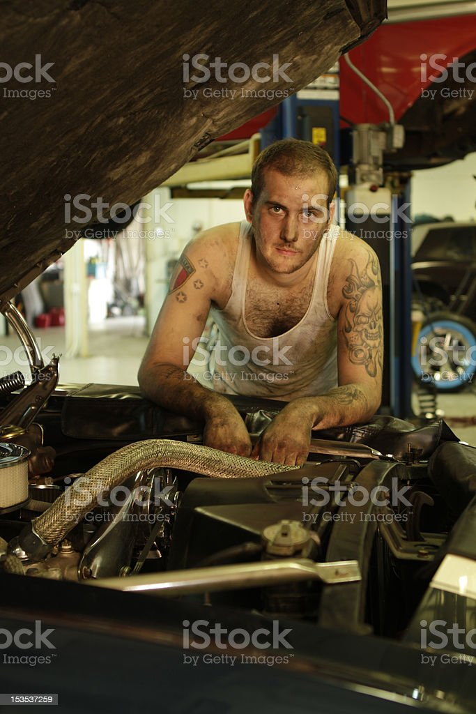 Portrait of a man working on classic car royalty-free stock photo