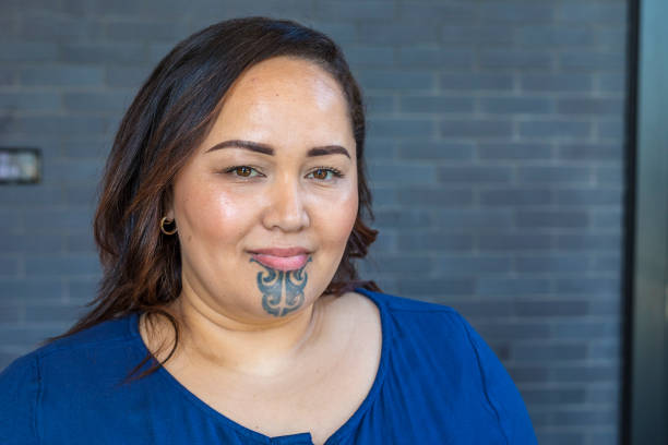 portrait of a maori woman with a face tattoo or moko - maori stock photos and pictures