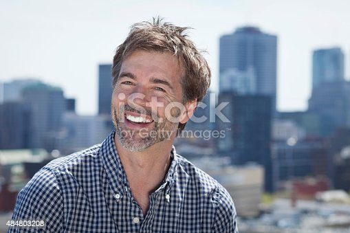637538262istockphoto Portrait Of A Mature Active Man Smiling In a city 484803208