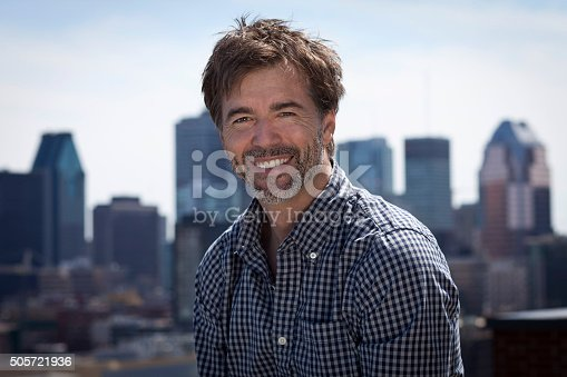 637538262istockphoto Portrait Of A Mature Active Man Smiling In a city 505721936