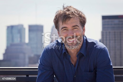 637538262istockphoto Portrait Of A Mature Active Man Smiling In town 474399204