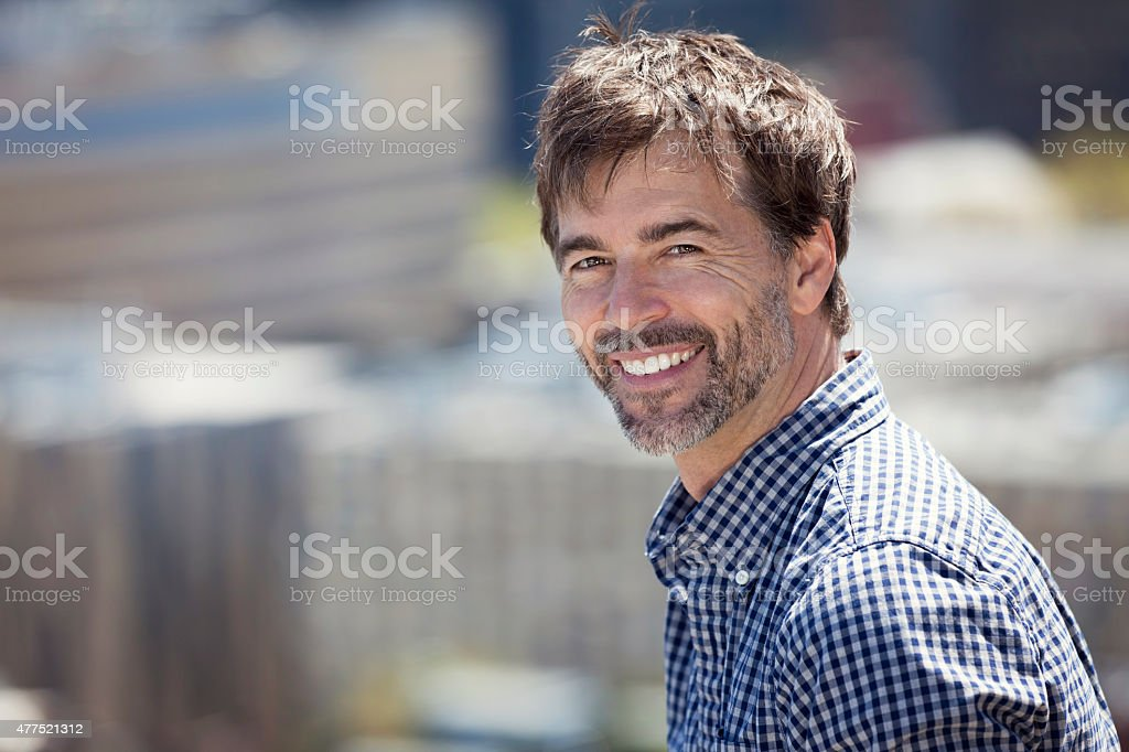 Portrait Of A Mature Active Man Smiling In town stock photo