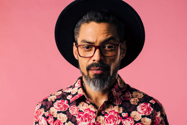 portrait of a mature artist with beard, glasses and hat - hipster fashion stock photos and pictures
