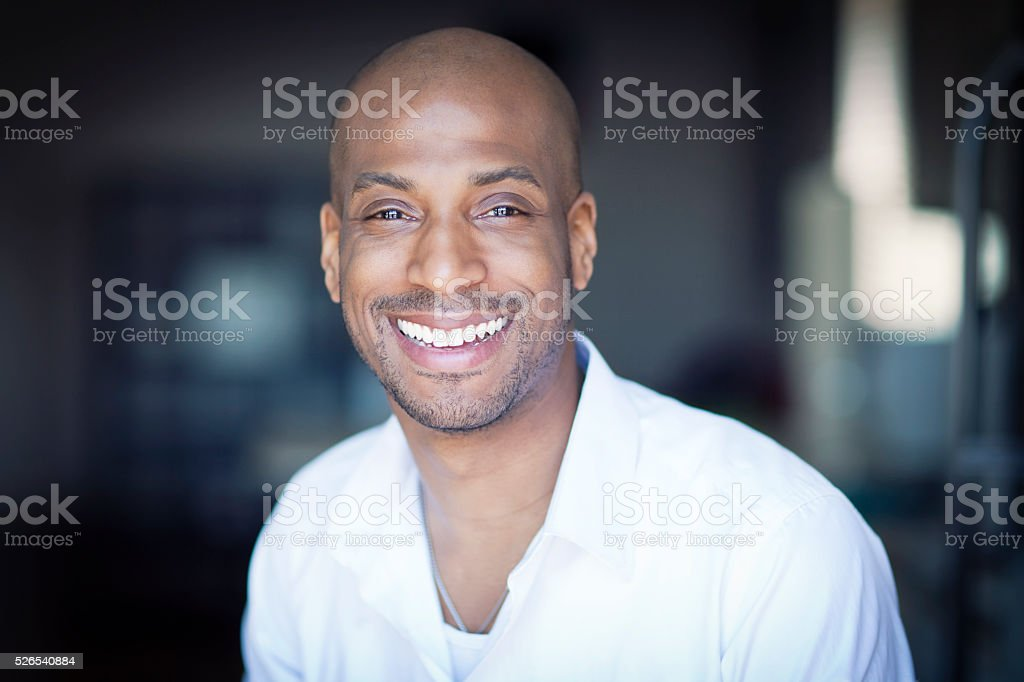 Portrait Of A Mature Black Man Smiling At Home stock photo