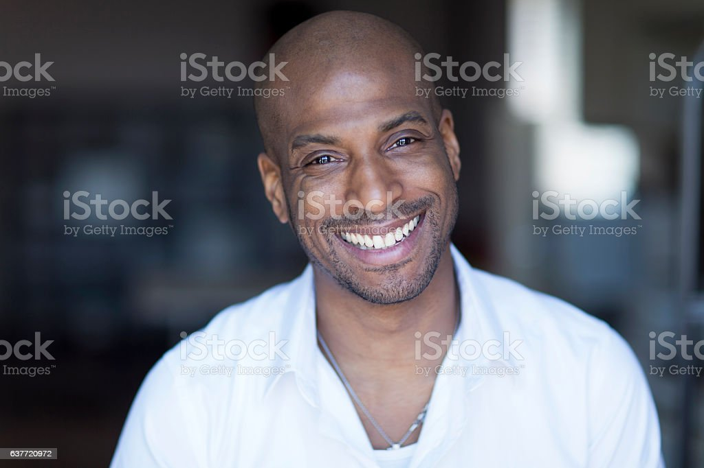 Portrait Of A Mature Black Man Smiling At The Camera.Home stock photo