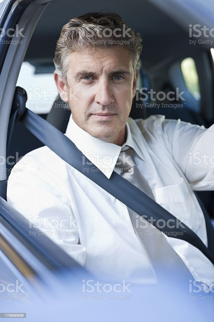 Portrait of a mature businessman driving car royalty-free stock photo