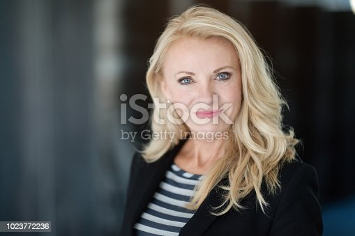 istock Portrait Of A Mature Businesswoman Smiling At The Camera 1023772236