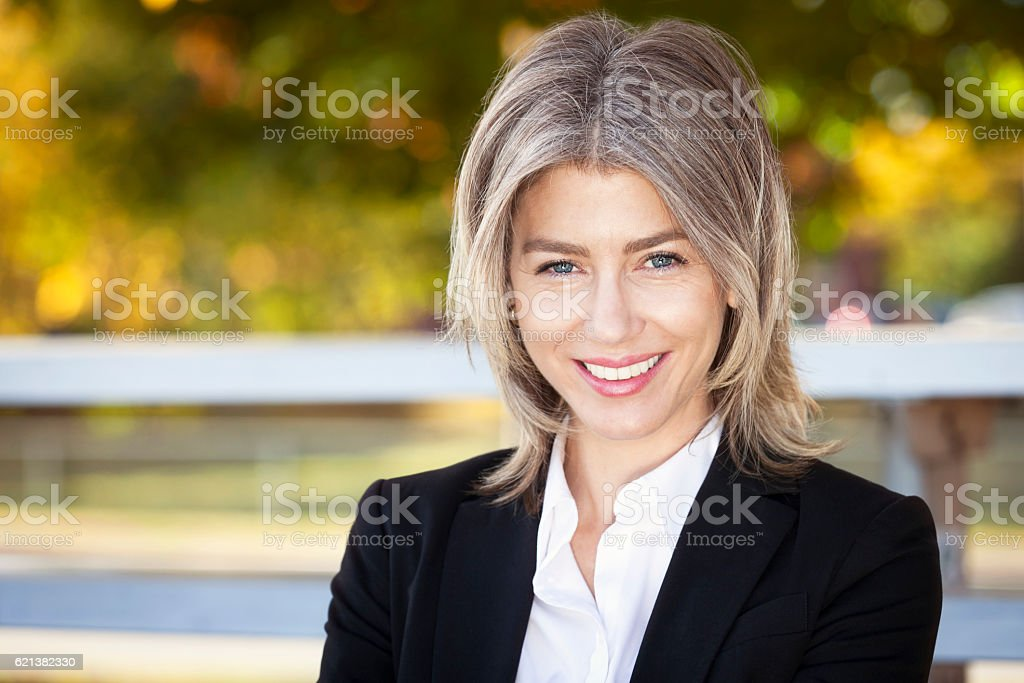 Portrait Of A Mature Businesswoman Smiling At The Camera stock photo