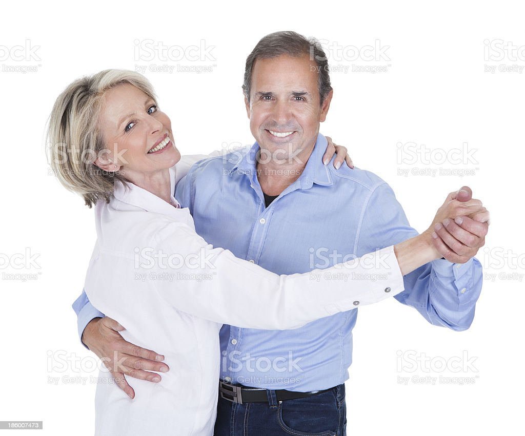 Portrait of a mature couple dancing together royalty-free stock photo