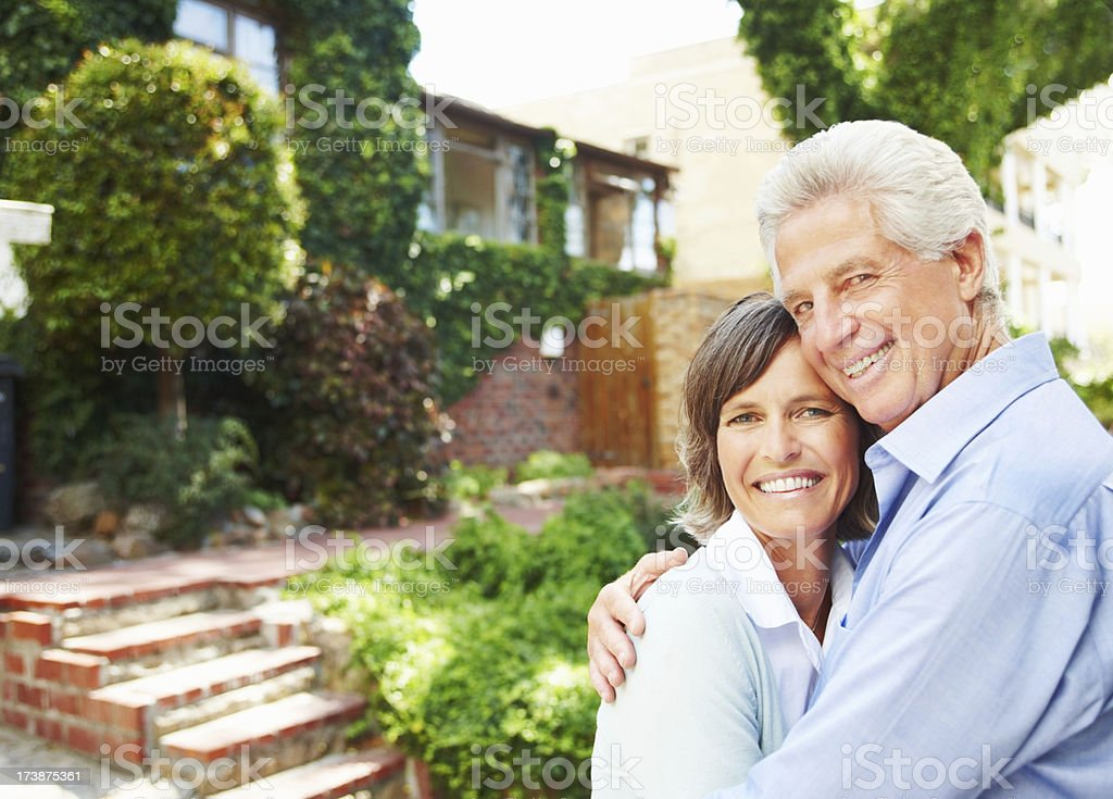 Portrait of a mature couple hugging and smiling royalty-free stock photo