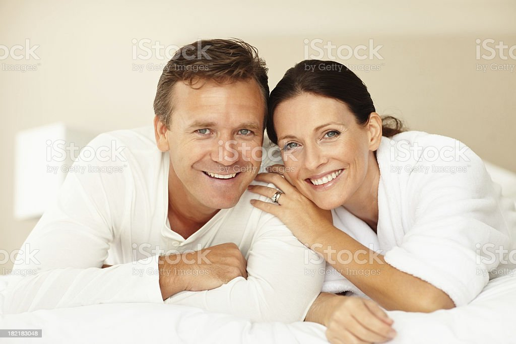 Portrait of a mature couple lying on bed royalty-free stock photo