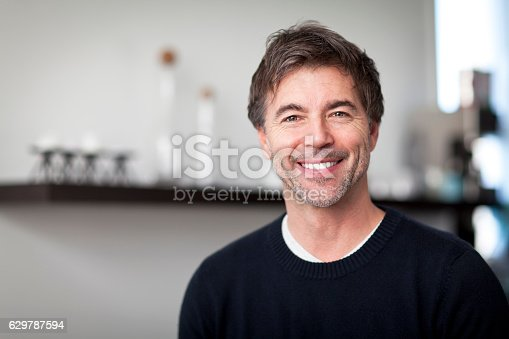 637538262istockphoto Portrait Of A Mature Handsome Man Smiling At The Camera 629787594