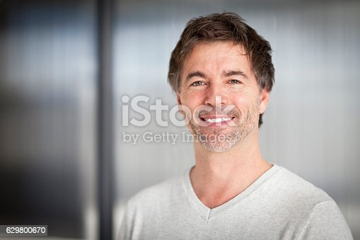 637538262istockphoto Portrait Of A Mature Handsome Man Smiling At The Camera 629800670