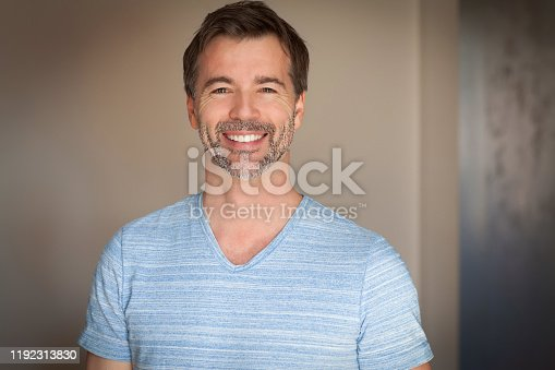 637538262istockphoto Portrait Of A Mature Man Smiling At The Camera. Casual shirt. Happy 1192313830
