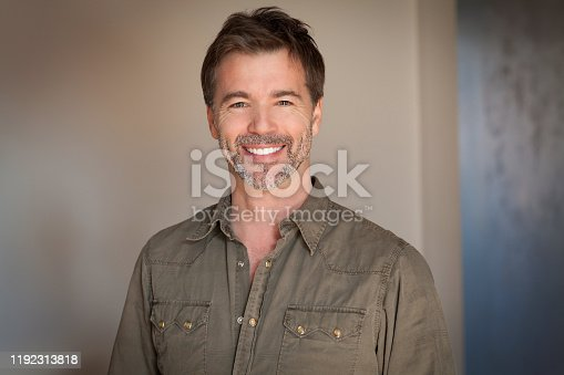 637538262istockphoto Portrait Of A Mature Man Smiling At The Camera. Home 1192313818