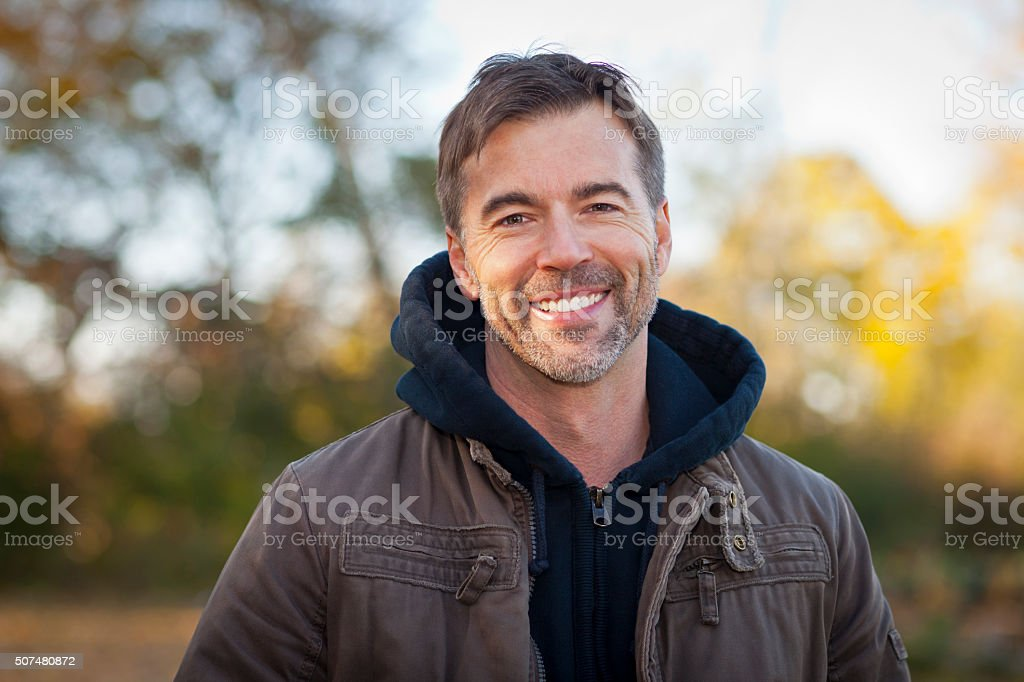 Portrait of A Mature Man Smiling at the camera Portrait of A Mature Man Smiling At The Park 50-59 Years Stock Photo