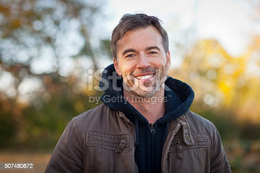 istock Portrait of A Mature Man Smiling at the camera 507480872