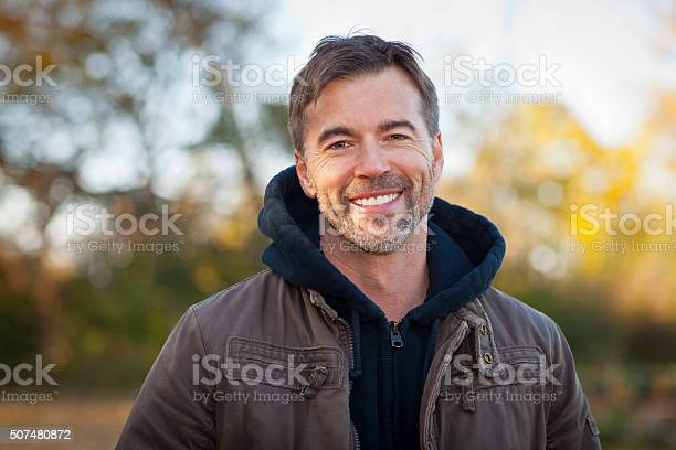 Portrait Of A Mature Man Smiling At The Camera Stock Photo - Download Image Now
