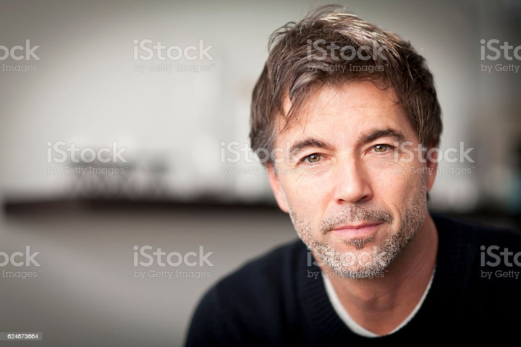 Portrait Of A Mature Man Smiling stock photo