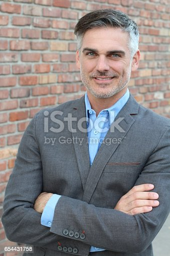 464621546 istock photo Portrait of a mature man smiling 654431758