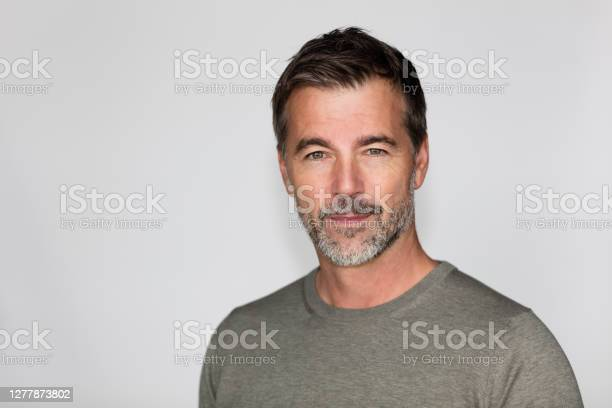 Portrait Of A Mature Man With A Little Smile At The Camera Right Side Of The Picture Stock Photo - Download Image Now