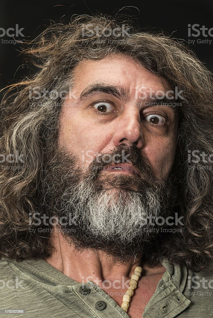 Portrait of a mature real man on black background. - Stock image .
