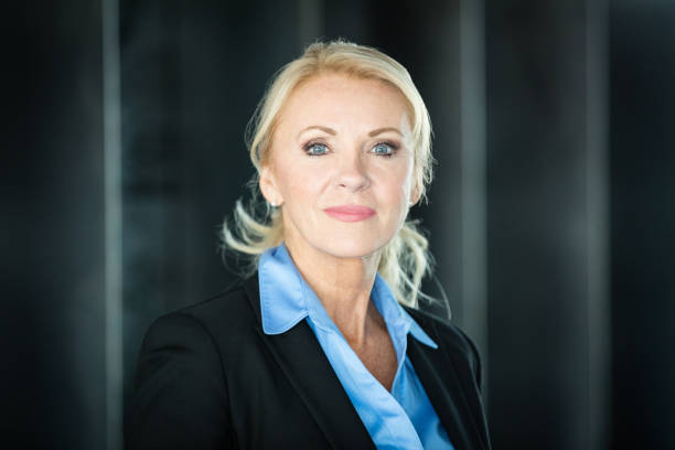 Portrait Of A Mature Serious Businesswoman Looking At The Camera stock photo