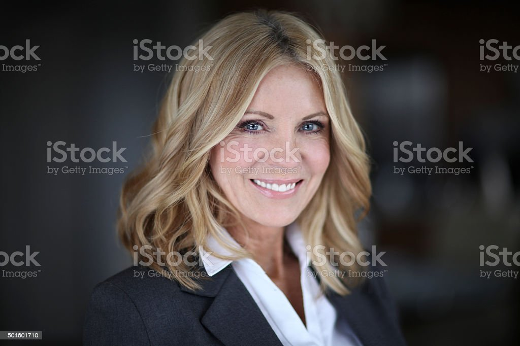 Portrait Of A Mature Woman Smiling At The Camera Portrait Of A Mature Businesswoman Smiling At The Camera 40-49 Years Stock Photo