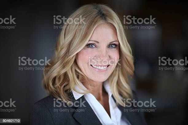 Portrait Of A Mature Woman Smiling At The Camera Stock Photo - Download Image Now