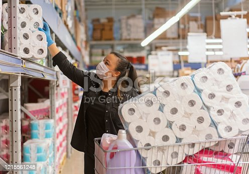 Portrait of a mature woman wearing a protective mask shopping in a supermarket