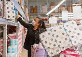 istock Portrait of a mature woman wearing a protective mask shopping in a supermarket 1215561248