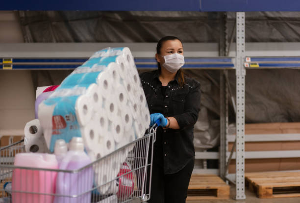 Portrait of a mature woman wearing a protective mask shopping in a supermarket stock photo