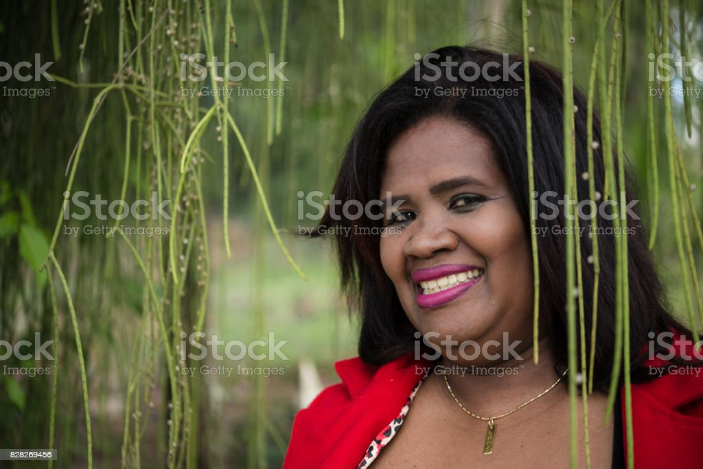 Portrait of a mature woman wearing red coat stock photo