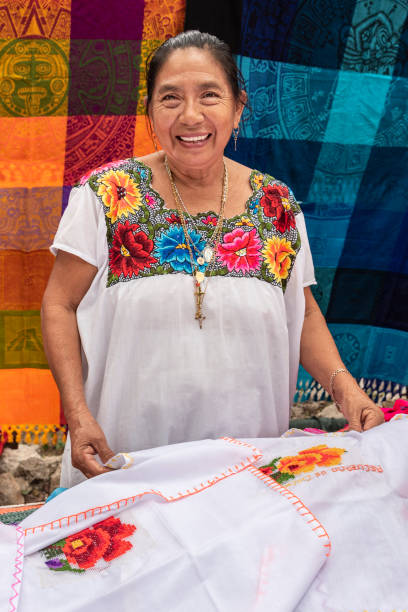 Portrait of a Mayan woman in Yucatan. Tailor specializing in embroidery clothing mexican culture stock pictures, royalty-free photos & images