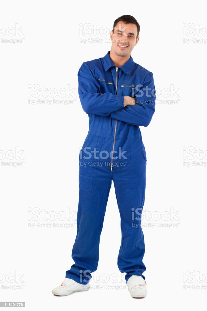 Portrait of a mechanic with the arms crossed stock photo